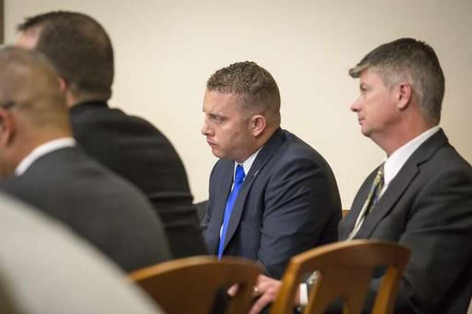 Former police officer Dominique Perez listens to testimony by Keith Sandy during their murder trial in Bernalillo County court, Monday, Oct. 5, 2016 in Albuquerque, N.M. Sandy and Perez are charged with the 2014 shooting death of James Boyd in March 2014. (AP Photo/Juan Labreche)