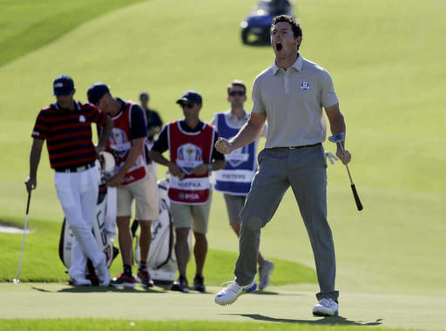 Europe's Rory McIlroy celebrates after putting on the 10th hole during a four-ball match at the Ryder Cup golf tournament Saturday, Oct. 1, 2016, at Hazeltine National Golf Club in Chaska, Minn. (AP Photo/Chris Carlson)