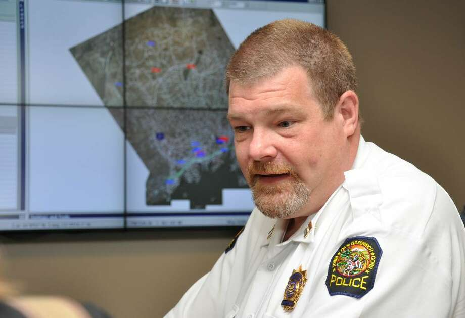 Greenwich Police Captain, Mark Marino, explains how the department's new high tech dispatch center utilizes GPS maps and compter systems to give real time locations of police cruisers. Photo: Amy Mortensen / Connecticut Post