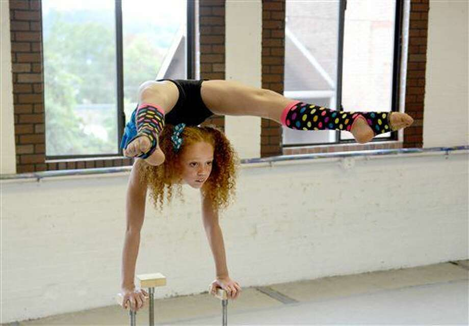 In a Monday, Sept. 26, 2016 photo, Bella Gantt, a 10-year-old 5th grader from Greensburg, Pa., practices her contortionist routine at Dance Extensions Performing in Canonsburg, Pa. Bella has become an internet sensation, with videos of her performances going viral on YouTube and the promise of stardom soon to come through national television performances. (Michael Henninger/Post-Gazette via AP)
