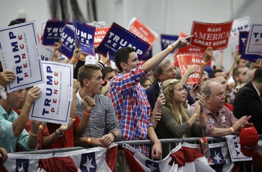People cheer as Republican presidential candidate Donald Trump speaks at a rally, Saturday, Oct. 1, 2016, in Manheim, Pa. (AP Photo/John Locher)