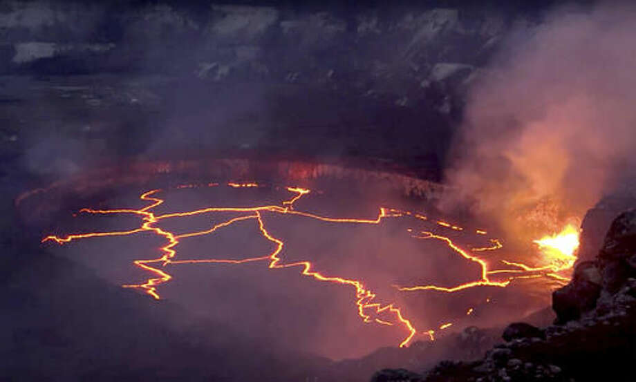 In this July 2016 image taken from video provided by the United States Geological Survey, the lava lake atop Kilauea volcano erupts on Hawaii's Big Island. Federal officials released new high definition video of the lava lake atop the active volcano on Tuesday, Oct. 4, 2016, providing a rare close-up glimpse of the powerful summit eruption. (United States Geological Survey via AP)