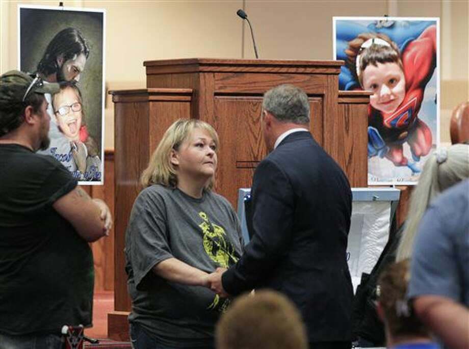 Rebecca Hunnicutt, left, an aunt of Jacob Hall, listens to U.S. Sen. Jeff Duncan, R-S.C., during a wake service at Oakdale Baptist Church in Townville, S.C., Wednesday, Oct. 4, 2016. Jacob, a classmate and a teacher were shot last Wednesday as they left for recess. Authorities say the suspect, a 14-year-old boy, had shot his father to death before driving to Townville Elementary. The other student and teacher were treated and released from a hospital that day. (Ken Ruinard/The Independent-Mail via AP, Pool)