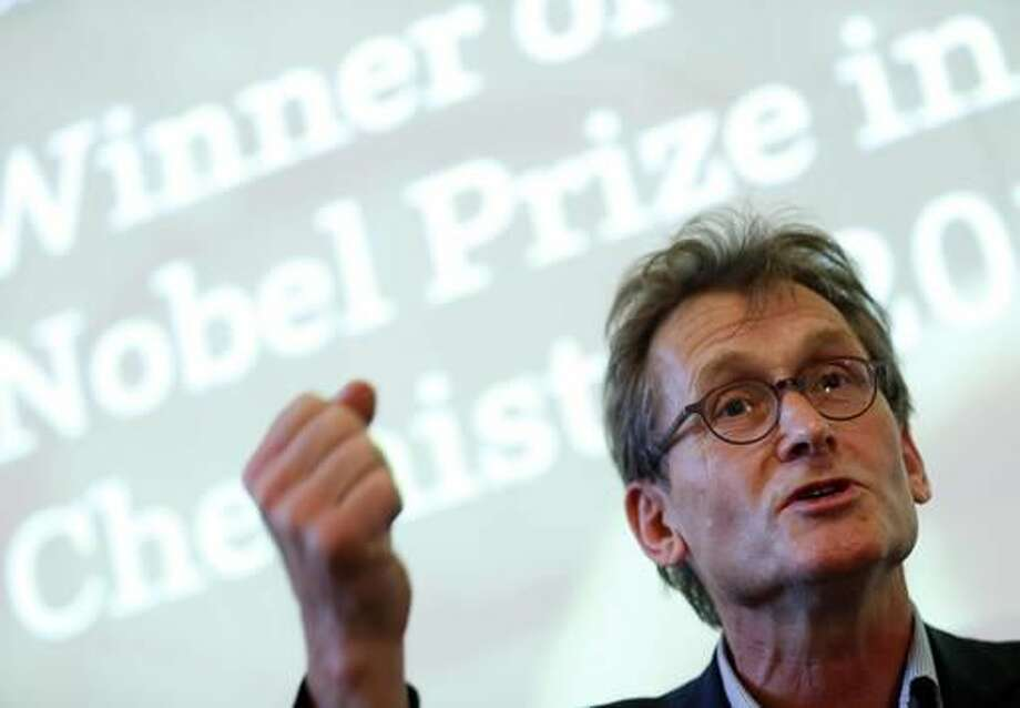 "Dutch scientist Bernard ""Ben"" Feringa gestures as he speaks during a press conference at the University of Groningen in the Netherlands, Wednesday Oct. 5, 2016 Feringa was one of the three scientists who won the Nobel Prize in chemistry on Wednesday for developing the world's smallest machines, work that could revolutionise computer technology and lead to a new type of battery. (AP Photo/Peter Dejong)"