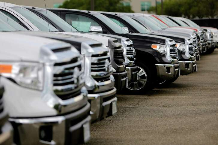 Trucks are lined up at a Sterling McCall Toyota dealership.
