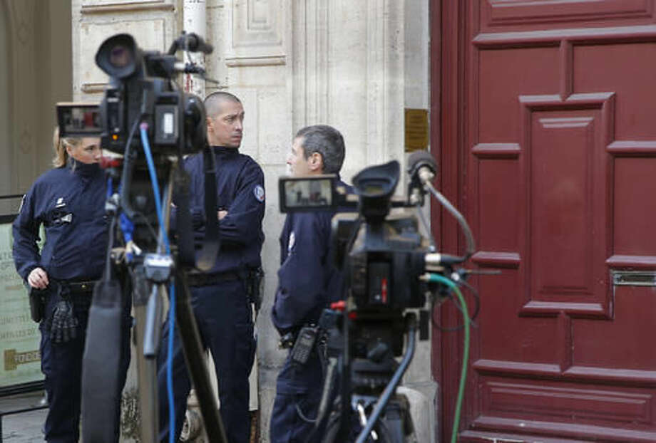French police officers stand outside the residence of Kim Kardashian West in Paris Monday, Oct. 3, 2016. Kim Kardashian West was unharmed after being robbed at gunpoint of more than $10 million worth of jewelry inside a private Paris residence Sunday night, police officials said. (AP Photo/Michel Euler)
