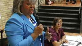 Barbara Gervin-Hawkins talks while Laura Thompson,R listens during debate between candidates for Texas House District 120, Democrat Barbara Gervin-Hawkins and independent Laura Thompson. Sponsored by San Antonio Observer at  Claude W. Black Community Center. Photos taken on 10/20/2016