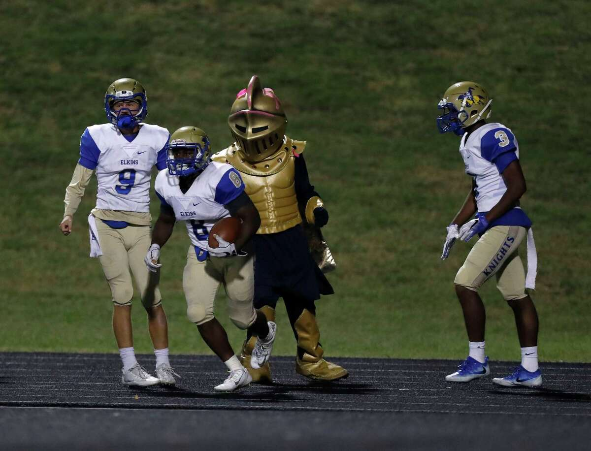 Elkins' Leonard Harris III (8) celebrates his touchdown in overtime during a high school football game between Elkins and Marshall at Hall Stadium, Thursday,Oct. 20, 2016 in Missouri City.