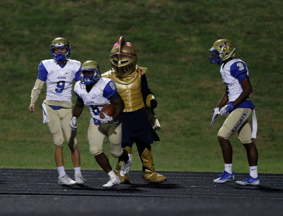 Elkins' Leonard Harris III (8) celebrates his touchdown in overtime during a high school football game between Elkins and Marshall at Hall Stadium, Thursday,Oct. 20, 2016 in Missouri City. Photo: Karen Warren, Houston Chronicle / 2016 Houston Chronicle