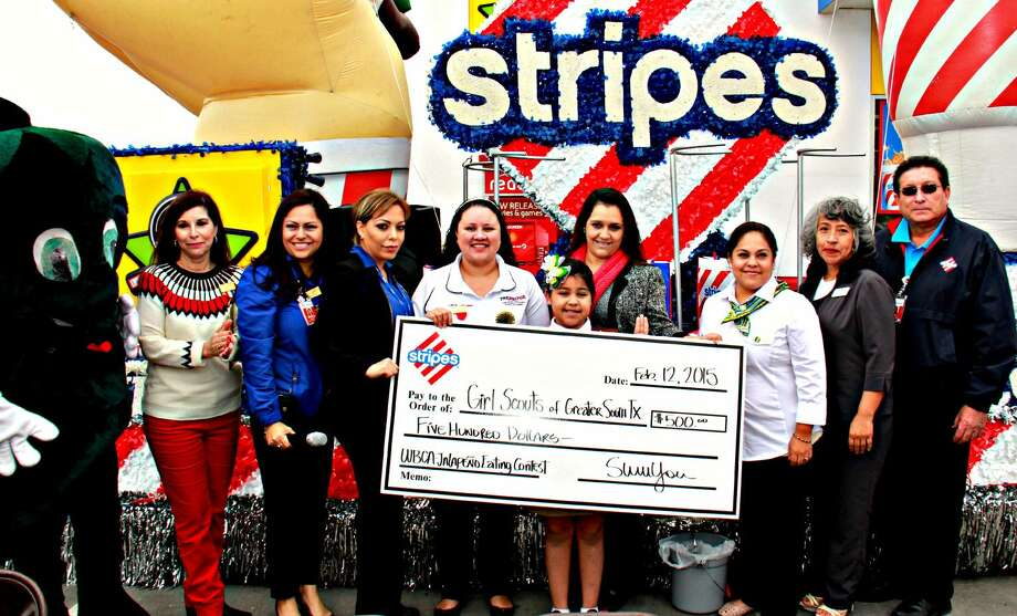 Stripes presents check to the Girl Scouts of Greater South Texas along with WBCA President Veronica Castillon and the winner of the event Judith Aguilar. (Courtesy photo)