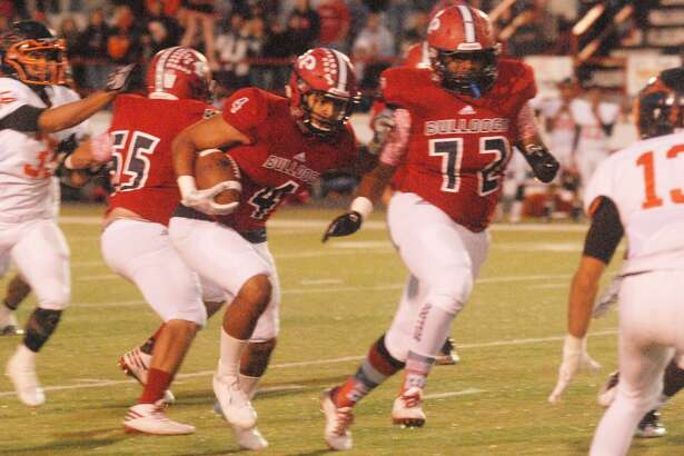 Plainview running back Trendan Jackson, 4, runs for yardage against Dumas in a game earlier this season as linemen Jaylon Borrego, 72, and David Bustos, 55, clear the way. Jackson rushed for 167 yards and three touchdowns against Caprock Thursday night.