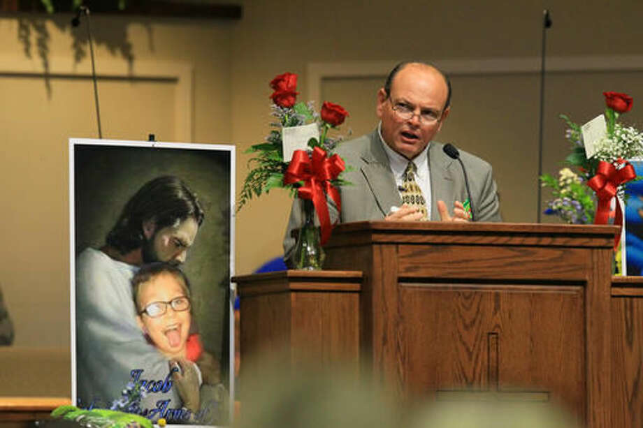 Tim Marcengill, Associate Pastor Evangelism and Education, speaks at funeral for Jacob Hall at Oakdale Baptist Church on Wednesday, Oct. 5, 2016, in Townville, S.C. Jacob's family has encouraged people to celebrate his life by dressing as the superheroes he loved. A 14-year-old boy killed his own father, then drove to Townville Elementary and fired on two children and a teacher as recess began. Jacob died Saturday. ( Ken Ruinard/The Independent-Mail via AP, Pool)