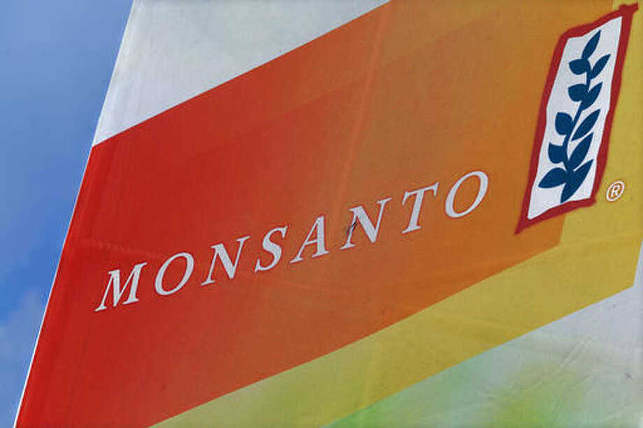 FILE - This Aug. 31, 2015, file photo, shows the Monsanto logo on display at the Farm Progress Show in Decatur, Ill. Monsanto reports financial results on Wednesday, Oct. 5, 2016. (AP Photo/Seth Perlman, File)