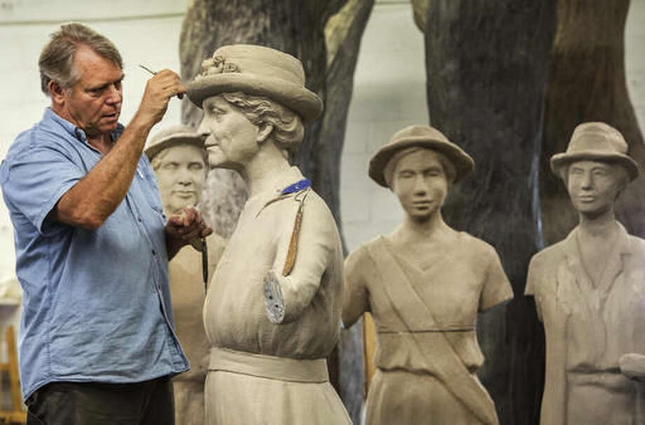 FILE - In this July 28, 2015, file photo, Artist Alan LeQuire works on a monument of women's suffrage leaders including Anne Dudley at his studio in Nashville, Tenn. Under proposed changes to Tennessee's social studies curriculum, public school students would no longer be required to be taught about Dudley's role in helping make Tennessee the 36th and deciding state to ratify the 19th Amendment to the U.S. Constitution in 1920, giving women the right to vote. (John Partipilo/The Tennessean via AP, File)