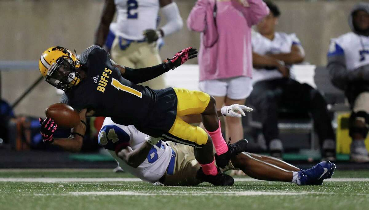 Marshall's Geovonte Howard (1) nearly intercepts a ball intended for Elkins' wide receiver Vernon Harrell (84) during the second half of a high school football game between Elkins and Marshall at Hall Stadium, Thursday,Oct. 20, 2016 in Missouri City.