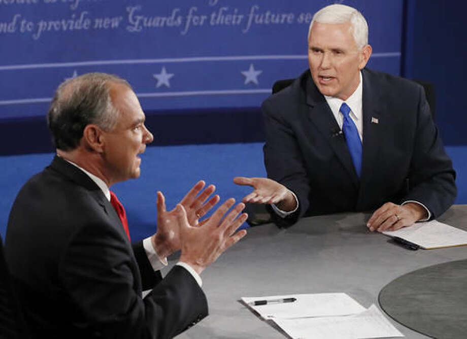 Republican vice-presidential nominee Gov. Mike Pence, right, and Democratic vice-presidential nominee Sen. Tim Kaine speak during the vice-presidential debate at Longwood University in Farmville, Va., Tuesday, Oct. 4, 2016. (Andrew Gombert/Pool via AP)