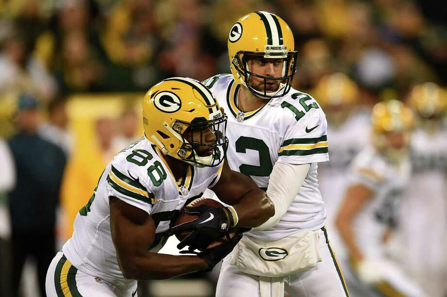 GREENBAY, WI - OCTOBER 20: Quarterback Aaron Rodgers #12 of the Green Bay Packers hands the ball off to teammate wide receiver Ty Montgomery #88 against the Chicago Bears in the first quarter at Lambeau Field on October 20, 2016 in Green Bay, Wisconsin. (Photo by Stacy Revere/Getty Images) ORG XMIT: 663672671 Photo: Stacy Revere / 2016 Getty Images