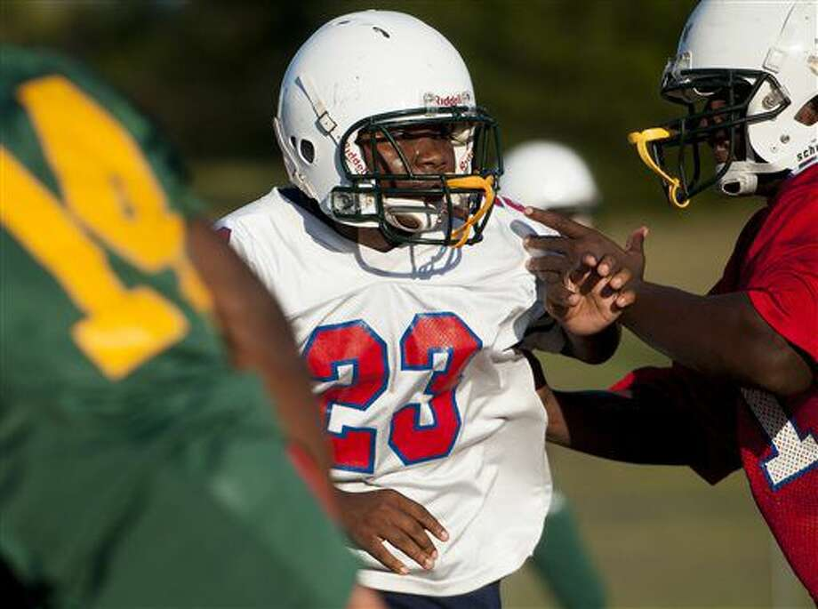 In this Monday, Oct. 3, 2016 photo, Central Hayneville High School football player Swanique Gordon, right, practices with teammates at the school near Hayneville, Ala. Gordon, a girl, is a starting linebacker with the team. (Mickey Welsh/The Montgomery Advertiser via AP)