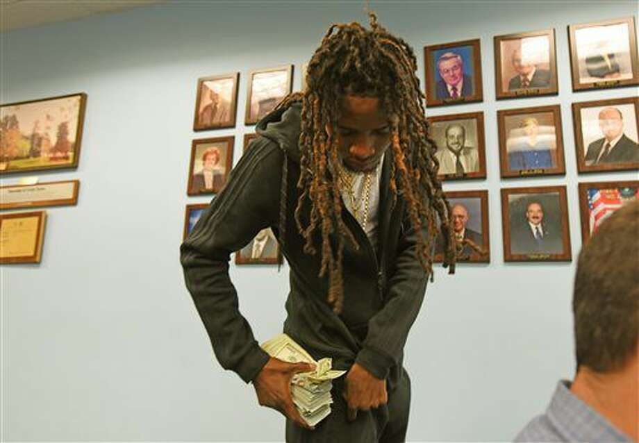 Rapper Fetty Wap appears in Cedar Grove Municipal Court in Cedar Grove, N.J., on Wednesday, Oct. 5, 2016, after he was stopped for tinted windows and other minor infractions. Also known as Willie J. Maxwell II, he pleaded guilty to all four charges, with fines totaling $360. (Viorel Florescu/The Record via AP)