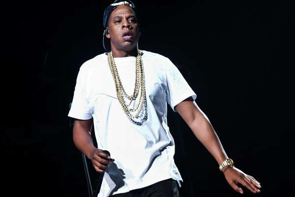 FILE - In this Oct. 10, 2013 file photo, U.S singer Jay-Z performs on stage at the O2 arena in London, as part of his Magna Carta World Tour.  (Photo by Joel Ryan/Invision/AP, File). According to a study conducted by the University of London and Imperial College released on Wednesday, May 6, 2015, the impact of hip-hop's arrival on the pop music scene has eclipsed that of the Beatles-led British invasion of 1964. ORG XMIT: LJC102