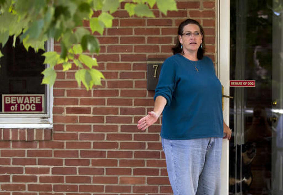 Debbie the wife of Harold Thomas Martin III, talks to reporters outside of her home in Glen Burnie, Md., Wednesday, Oct. 5, 2016. A federal government contractor is accused of stealing highly classified information. The Justice Department on Wednesday announced a criminal complaint against Harold Thomas Martin III of Glen Burnie, Maryland (AP Photo/Jose Luis Magana)