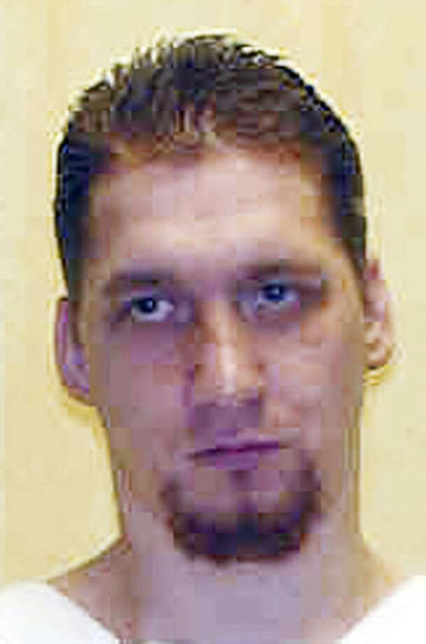 FILE - This undated file photo provided by the Ohio Department of Rehabilitation and Correction shows death row inmate Ronald Phillips, convicted of the 1993 rape and murder of his girlfriend's 3-year-old daughter in Akron, Ohio. Phillips asked a federal court to postpone his scheduled Jan. 12, 2017, execution in legal documents filed Friday, Nov. 11, 2016, to allow more time to hear his challenge to Ohio's new three-drug method to carry out death sentences. (Ohio Department of Rehabilitation and Correction via AP, File) Photo: Uncredited