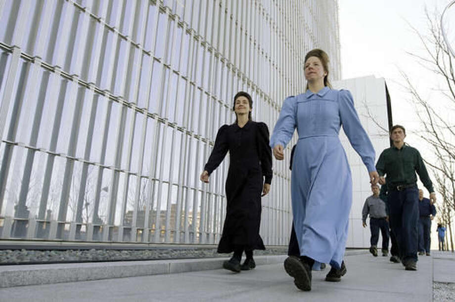 FILE--In this April 6, 2016, file photo, members of the fundamentalist Church of Jesus Christ of Latter Day Saints leave the Federal Courthouse following detention status hearing for high-ranking polygamous leader Lyle Jeffs in Salt Lake City. Polygamous sect leader and brother of Lyle Jeffs, Seth Jeffs, charged with fraud, said in court in Salt Lake City, Utah, Tuesday, Oct. 4, 2016, that not sharing goods purchased with food stamps would prohibit him and others from living their religion and being prepared for heaven. (AP Photo/Rick Bowmer, file)