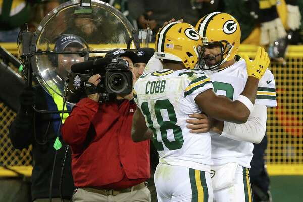 GREENBAY, WI - OCTOBER 20: Wide receiver Randall Cobb #18 of the Green Bay Packers celebrates with teammate quarterback Aaron Rodgers #12 after scoring a fourth quarter touchdown against the Chicago Bears at Lambeau Field on October 20, 2016 in Green Bay, Wisconsin.