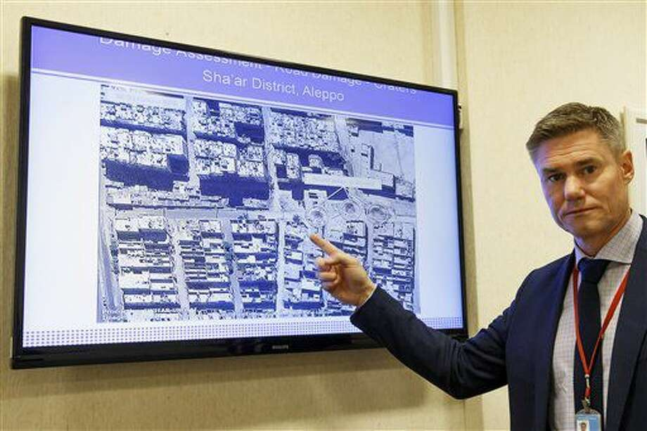 Einar Bjorgo, UNOSAT manager, shows a satellite image of a destroyed road of a district in Aleppo, which was taken on Sept. 26, 2016 during a press conference at the European headquarters of the United Nations in Geneva, Switzerland, Wednesday, Oct. 5, 2016. (Salvatore Di Nolfi/Keystone via AP)