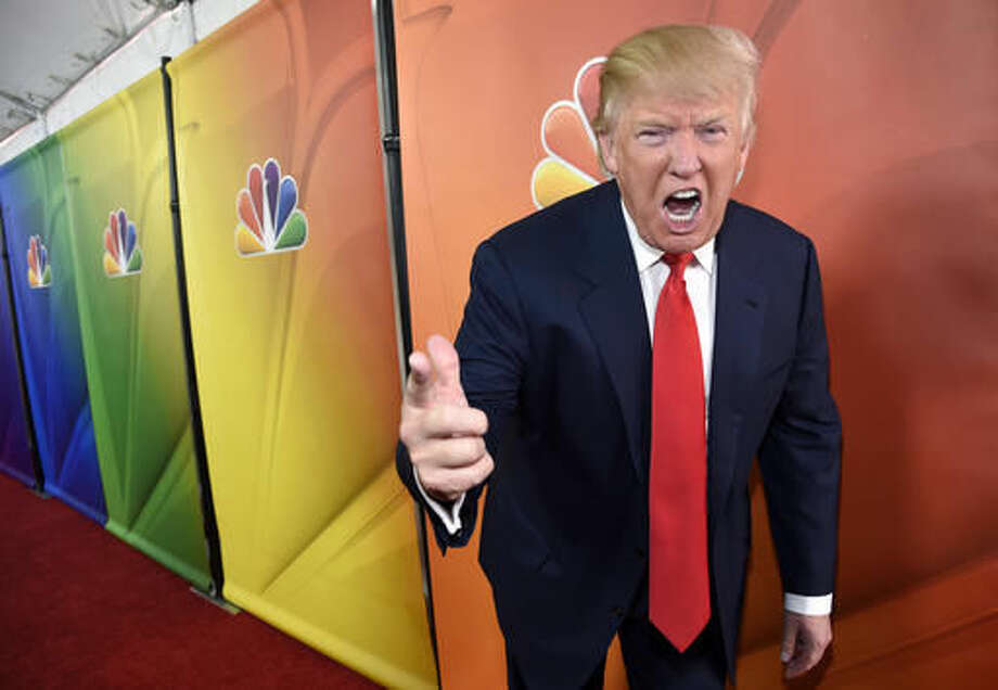 """FILE - In this Jan. 16, 2015 file photo, Donald Trump, host of the reality television series """"The Celebrity Apprentice,"""" poses for photographers at the NBC 2015 Winter TCA Press Tour in Pasadena, Calif. In his years on the """"The Apprentice,"""" Trump repeatedly demeaned women with sexist language, according to show insiders who said he rated female contestants by the size of their breasts and talked about which ones he'd like to have sex with. (Photo by Chris Pizzello/Invision/AP, File)"""