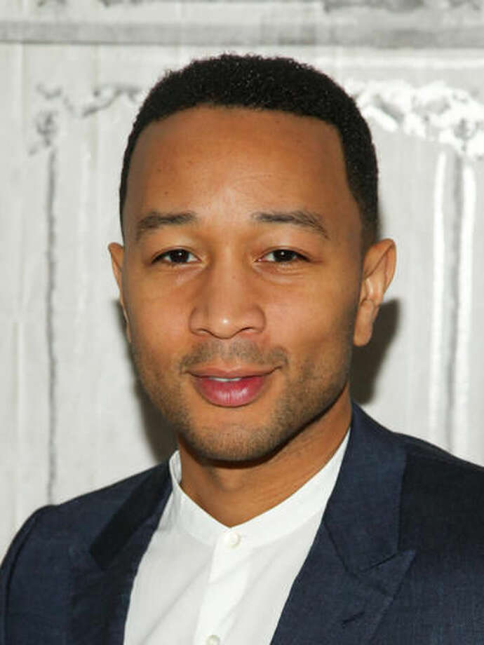 "File- This March 9, 2016, file photo shows John Legend at AOL's BUILD Speaker Series to discuss his 10-episode WGN Network series ""Underground"" at AOL Studios in New York. The Oscar- and Grammy-winning artist is set to perform at the dedication of a recently renovated $2.5 million theater that's named in his honor.(Photo by Andy Kropa/Invision/AP, File)"