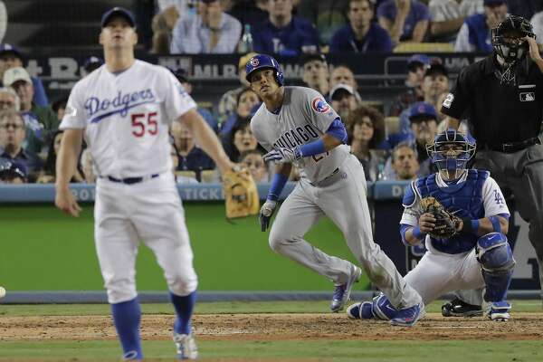 Chicago Cubs' Addison Russell hits a two-run home run off Los Angeles Dodgers relief pitcher Joe Blanton during the sixth inning of Game 5 of the National League baseball championship series Thursday, Oct. 20, 2016, in Los Angeles. (AP Photo/Jae C. Hong)