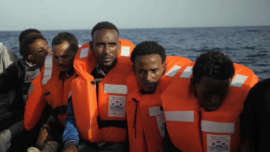 A rescue boat is filled with migrants taken from a vessel in the Mediterranean Sea off the coast of Libya in this Tuesday Oct. 4, 2016 image taken from video. At least 33 people died on Tuesday trying to reach Europe by crossing the Mediterranean Sea from Libya. (AP Photo)