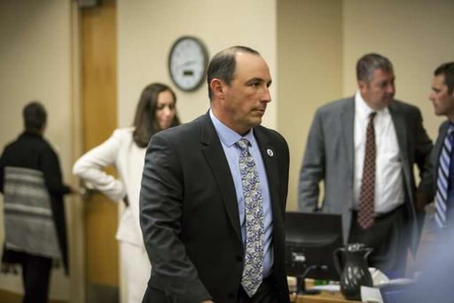 Keith Sandy, former APD detective, walks from the witness stand during his murder trial in Bernalillo County court, Monday, Oct. 5, 2016 in Albuquerque, N.M. Sandy and former Albuquerque police officer Dominique Perez are charged with the 2014 shooting death of James Boyd in March 2014. (AP Photo/Juan Labreche)