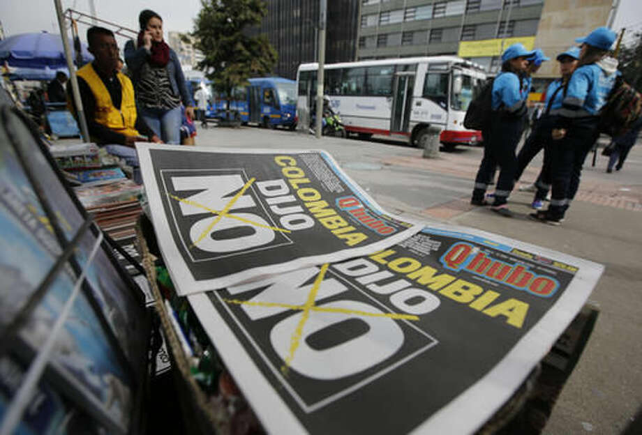 "Newspapers headlines read in Spanish; ""Colombia said No"", in Bogota, Colombia, Monday, Oct. 3, 2016. Voters rejected a peace deal with leftist rebels of the Revolutionary Armed Forces of Colombia, FARC, by a razor-thin margin in a national referendum Sunday, dismissing years of negotiations and delivering a setback to President Juan Manuel Santos. Final results showed that 50.2 percent opposed the accord, while 49.8 percent favored it. (AP Photo/Fernando Vergara)"