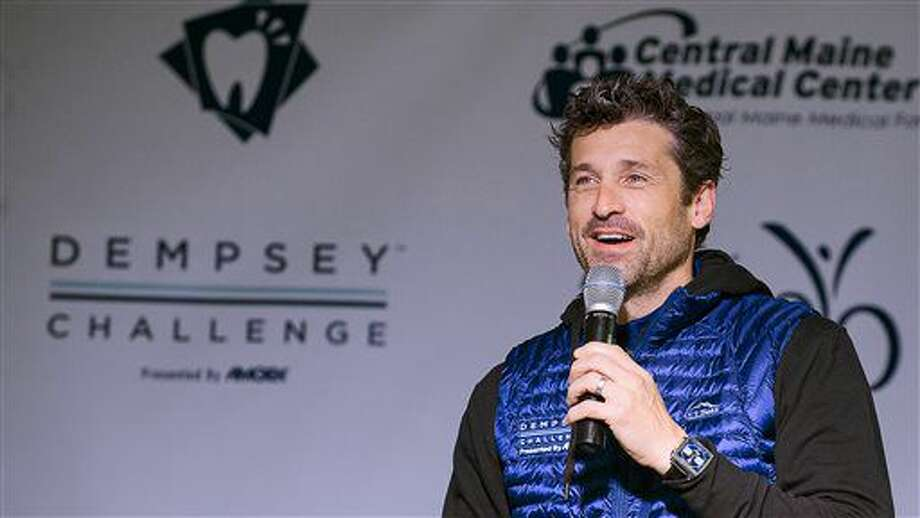 """Actor Patrick Dempsey welcomes the crowd prior to the start of the bike-and-run """"Dempsey Challenge"""" Saturday, Oct. 1, 2016 in Lewiston, Maine. The Maine native, who plays a starring role in the new romance-comedy, """"Bridget Jones's Baby,"""" participated Saturday in a cancer survivor walk with his three children and two sisters. (Russ Dillingham/The Lewiston Sun-Journal via AP)"""
