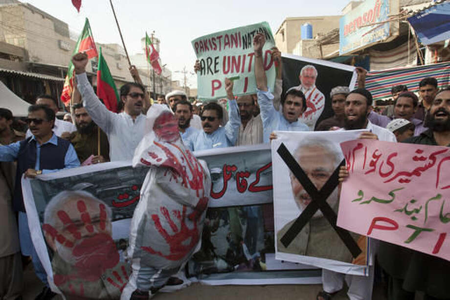 Supporters of Pakistan's political party Tehreek-e-Insaf rally against India in Karachi, Pakistan, Thursday, Oct. 6, 2016. Pakistan's powerful army chief lashed out at India Thursday, warning that any act of aggression from New Delhi would not go unpunished as tensions spike between the two countries over the divided region of Kashmir. (AP Photo/K.M. Chaudary)