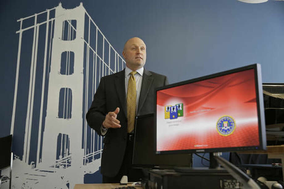 In this photo taken Tuesday, Sept. 27, 2016, FBI Special Agent Jack Bennett answers a question while posing in one of the bureau's modernized offices in San Francisco. The FBI's new leader in San Francisco is a former drug investigator who developed expertise in technology that put him at the center of the government's effort to unlock an iPhone used by one of the San Bernardino shooters. Bennett now has oversight responsibilities for Silicon Valley. (AP Photo/Eric Risberg)