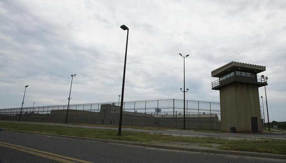 This 2014 photo shows the exterior of the Eastern Correctional Institution in Westover, M.D. Correctional officers at Maryland's largest state prison for years helped scores of inmates smuggle narcotics, tobacco, pornography and cellphones into the facility in exchange for money and sex, according to a pair of sweeping federal indictments unsealed Wednesday, Oct. 5, 2016. (Laura Emmons/The Daily Times via AP)