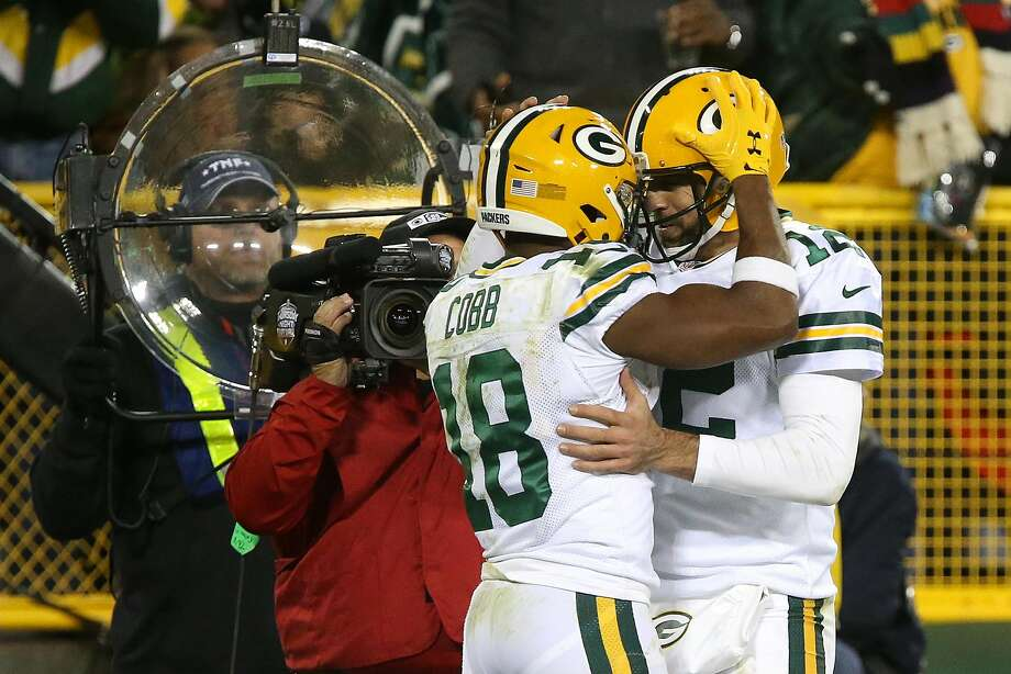 Green Bay's Randall Cobb celebrates with Aaron Rodgers after scoring a fourth-quarter touchdown. Photo: Dylan Buell, Getty Images