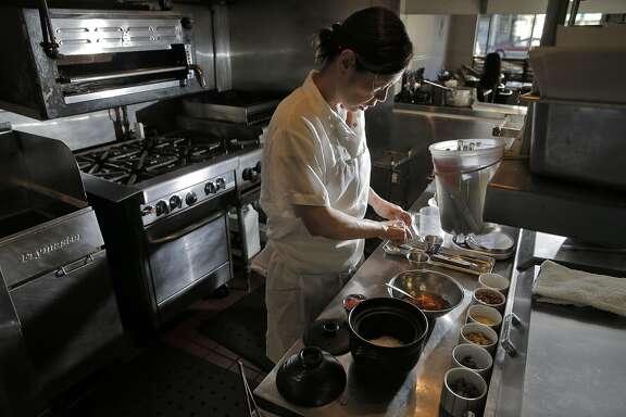 Chef Miyuki Hasegawa prepares Salmon Rice topped with Ikura in a donabe, at Yukuzi Japanese Eatery in San Francisco, Calif., on Thursday, October 20, 2016.