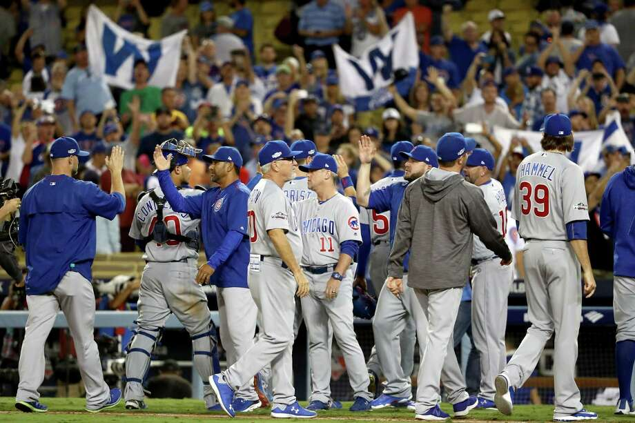 LOS ANGELES, CA - OCTOBER 20:  Chicago Cubs fans cheer after the Cubs 8-4 victory against the Los Angeles Dodgers in game five of the National League Division Series at Dodger Stadium on October 20, 2016 in Los Angeles, California. Photo: Sean M. Haffey, Getty Images / 2016 Getty Images