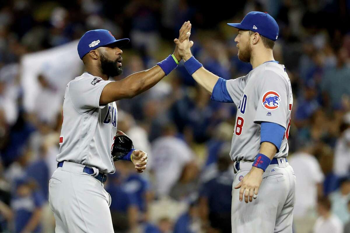 LOS ANGELES, CA - OCTOBER 20: Jason Heyward #22 and Ben Zobrist #18 of the Chicago Cubs celebrate the Cubs 8-4 victory against the Los Angeles Dodgers in game five of the National League Division Series at Dodger Stadium on October 20, 2016 in Los Angeles, California.