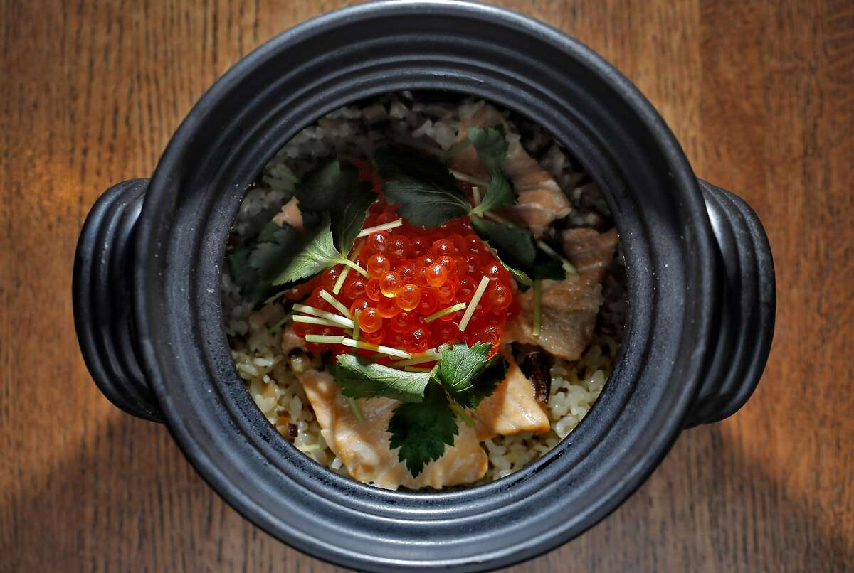 Salmon Rice topped with Ikura in a donabe, prepared by Chef Miyuki Hasegawa at Yukuzi Japanese Eatery in San Francisco, Calif., on Thursday, October 20, 2016.
