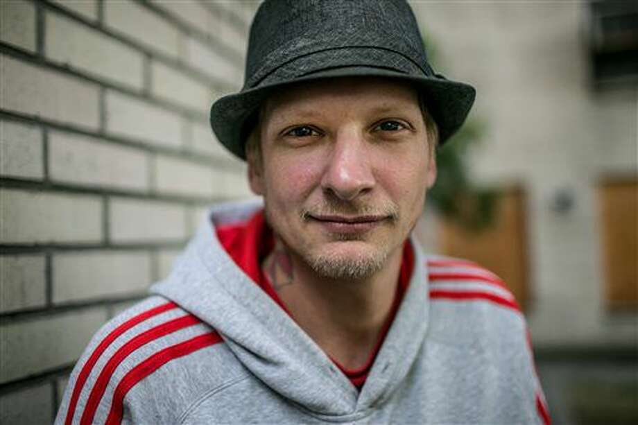 Eric Currie, a former Seattle Pain Centers patient, is photographed on Sept. 16, 2016 in Seattle. More than 1,500 former patients of Seattle Pain Centers have sought help in Washington emergency rooms since the chain of clinics was closed abruptly in July, and hundreds more have swamped local hospital programs. The Seattle Times reports some providers say they're struggling to meet the void left when the center's medical director, Dr. Frank Li, was stripped of his medical license for practices that state regulators said possibly contributed to the deaths of at least 18 patients since 2010. (Johnny Andrews/The Seattle Times via AP)