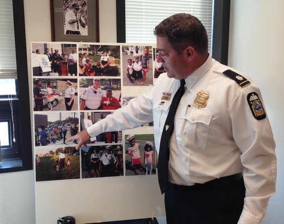 Commander Gary Cameron of the Columbus Division of Police points to pictures of officers who have participated in an annual anti-crime program on Wednesday, Oct. 5, 2016, in Columbus, Ohio. Police released statistics from the program, which has been criticized by protesters following two fatal shootings by officers. (AP Photo/Ann Sanner)