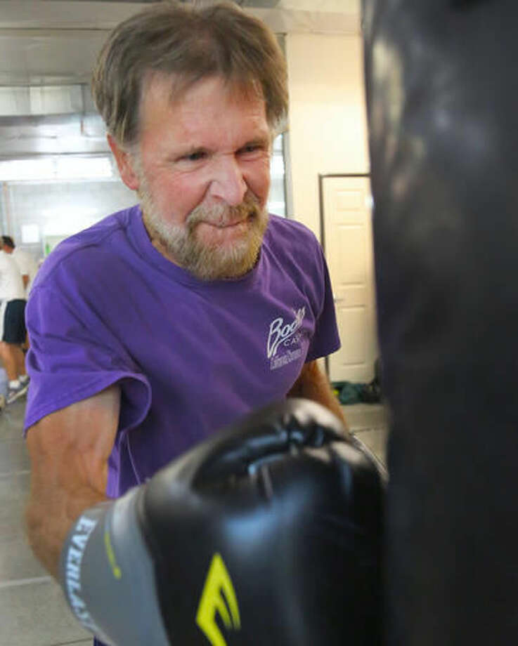In this Monday, Sept. 19, 2016 photo, Rick Gutierrez punches a body bag during the Parkinson's boxing program at the Tazmanian Boxing Club in Carson City, Nev. (Jim Grant /Nevada Appeal via AP)