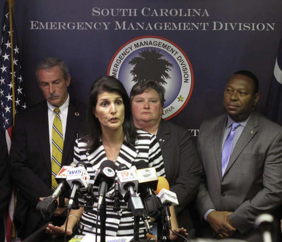 Gov. Nikki Haley announces that she plans to call for the evacuation of about 1 million people from South Carolina's coast as Hurricane Matthew threatens on Tuesday, Oct. 4, 2016, at the South Carolina Emergency Management Division headquarters in Pine Ridge, S.C. People along the East Coast entered better-safe-than-sorry mode Tuesday, flocking to hardware stores, grocery aisles and gas stations as Hurricane Matthew marched toward Florida, threatening to become the first hurricane to hit the state's Atlantic coast in over a decade. (AP Photo/Jeffrey Collins)