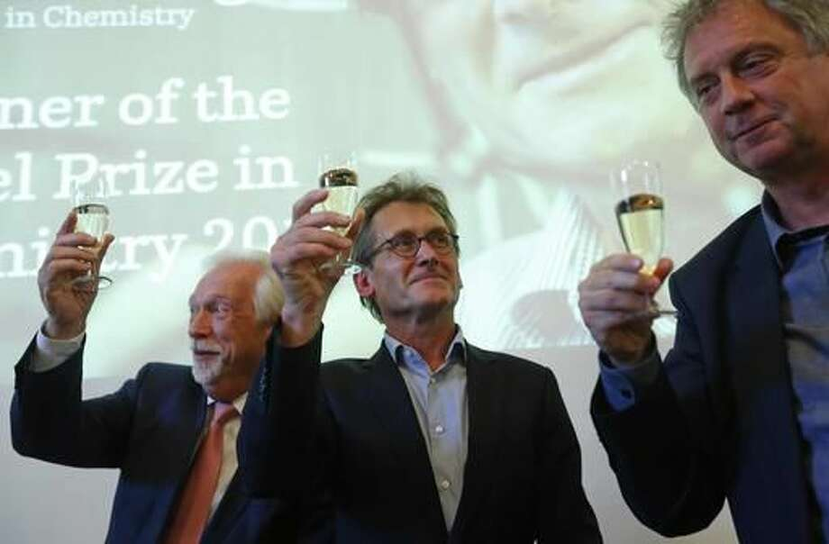 "Dutch scientist Bernard ""Ben"" Feringa, centre, Elmer Sterken, the Rector Magnificus at the University of Groningen, right, and Sibrand Poppema, the President of the University, toast with champagne after a press conference at the University of Groningen in the Netherlands, Wednesday Oct. 5, 2016 Feringa was one of the three scientists who won the Nobel Prize in chemistry on Wednesday for developing the world's smallest machines, work that could revolutionise computer technology and lead to a new type of battery. (AP Photo/Peter Dejong)"