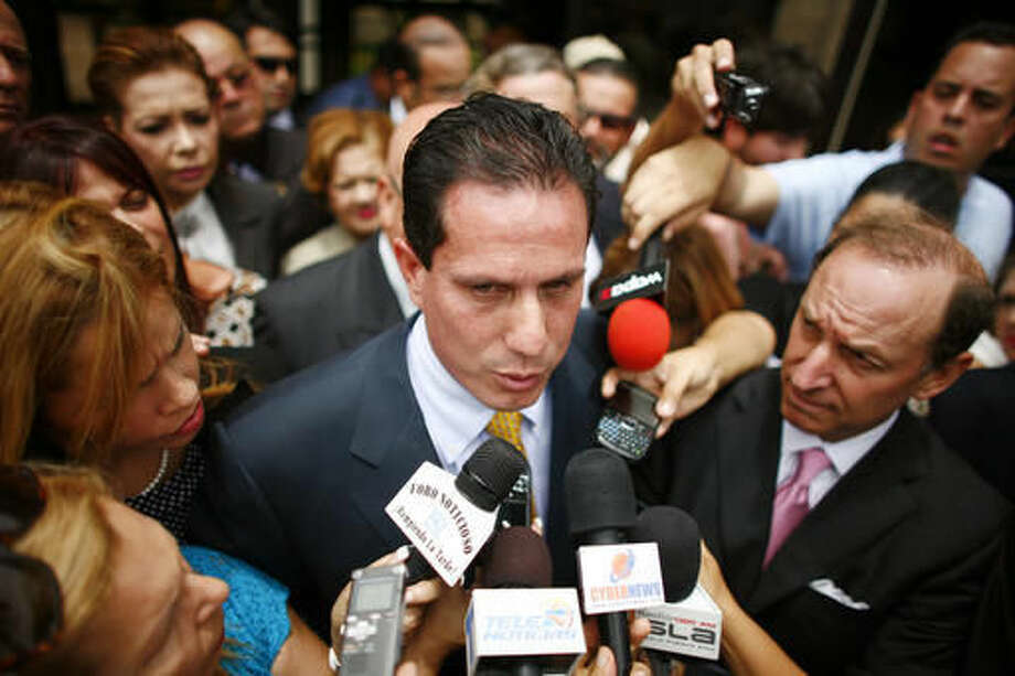 FILE - In this June 23, 2010 file photo, then-Puerto Rican Sen. Hector Martinez-Maldonado talks to reporters outside federal court in San Juan. The Supreme Court seems skeptical of Martinez-Maldonado's bid to avoid a second trial on bribery charges. The justices heard the first arguments of their new term Tuesday, Oct. 4, 2016, first up was an appeal from Martinez-Maldonado and a prominent businessman. (AP Photo/Ricardo Arduengo, File)
